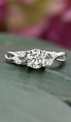 Beautiful nature-inspired engagement ring. I like how this has a branch-y look without actually being leaves and branches.