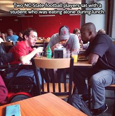 Two NC football players...this should happen every day. THE BEST! I love when the popular kids befriend the lonely kids.