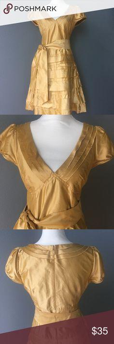 "Calypso Gold Silk Dress -gold silk -a line skirt -detachable sash -zipper up the back -cap sleeve Measurements laying flat -chest 15"" -shoulder to hem 36 1/2"" -waist/top of hip where first ruffle tier starts 17"" -bottom hem width 30"" Calypso St. Barth Dresses Midi"