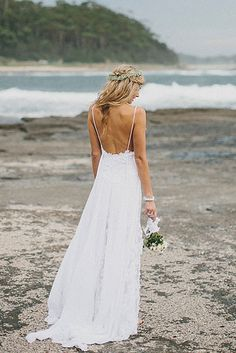 With delicate spaghetti straps. | 36 Of The Most Effortlessly Beautiful Boho Wedding Dresses Ever