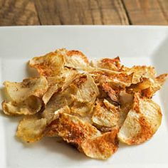 Baked Celeriac Chips, a healthy low carb snack to replace those unhealthy processed potato chips! A- delicious!! They shrink a lot. Cut about two times larger than you want them as your finished chip. Still slice thin though.
