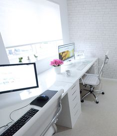 All-white home office with double desks