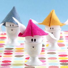 Easter Bunny Egg Cups  Dress up plain wooden eggs with colorful felt hats and ears with this adorable Easter decorating project.