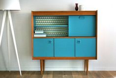 I love the blue and wood combo of this vintage sideboard!