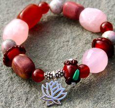 Jasper Gemstone with a lotus flower. Check it out now : http://www.ekdesignsjewelry.com/Merchant2/merchant.mvc?Screen=PROD&Store_Code=EDJ&Product_Code=gem0012&Category_Code=beads $50 #Gemstonebracelets #Graduationbracelets #Elasticgemstonebracelets #Healingbracelets #Gemstonejewelry