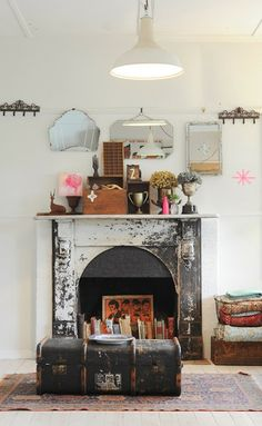 fire place, trunk, vintage, suitcase, storage, coffee table, old mirrors, shaped mirror, rug, living room, collection