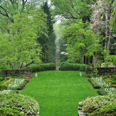 YARD – great design! One of my most favorite looks a boxed grass courtyard surrounded by hedges and towering large trees.....just breathtaking!
