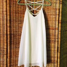 White slip dress Size Small Gorgeous, lined. Cross cross back detail. V front. Spaghetti straps.wide flows bottom. Just beautiful. Dresses