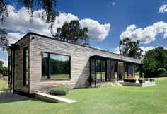 Modern prefab english mobile home with chesnut clad facade                                                                                                                                                                                 More
