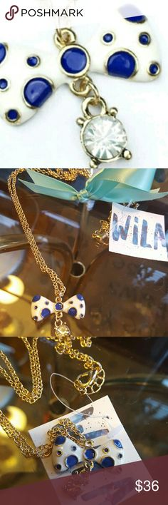Bow necklace Alloy plated beautiful white bow with blue Polk a dots and crystal dangle this long necklace could go with anything dress it up or dress it down wila Jewelry Necklaces
