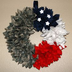 Since we're all Navy in our house, I think I may try this with the NWU's (Blue/water camis). ACU/American Flag wreath -- this is pretty awesome! --