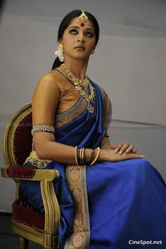 Beige and blue saree.  Model:  Anushka Shetty