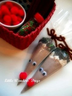 Hot Cocoa Mix in an icing bag, top with some mini marshmallows and tiny chocolate chips. Close bag with a brown chenille pipe cleaner then glue on google eyes and nose.