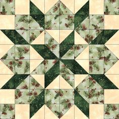 Quilt kit features the Bethlehem Star quilt block pattern with brown pine cones red berries and pine on green, falling snow on dark green and falling snow on cream. Make a nice blanket, throw, wall ha