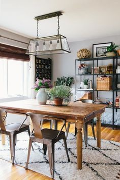 This rectangular chandelier with glass panes in metal frames combines industrial and rustic farmhouse styles.