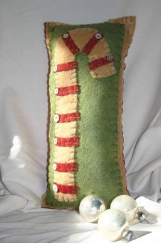 This Vintage style Christmas Candy Cane Pillow is hand sewn made of eco friendly felt and embellished with vintage white buttons. Front background