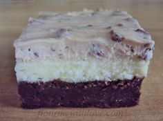 Flour Me With Love: Triple Layer Bars. First there is a fudgy layer of brownie, then a decadent layer of cheesecake, and to top it off...cookie dough frosting (there's no egg in the frosting so it's perfectly safe to eat.)