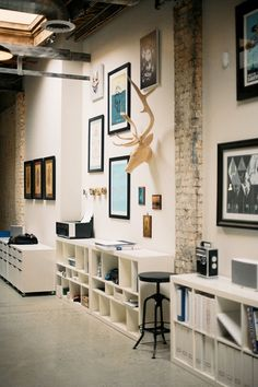 We Like Small Office Design - gallery art with functional storage