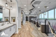 Like the flooring & wood chosen for walls. Can alternate the gray & brown in various areas to carry palate through office. Like the since countertop.