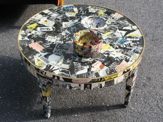 Decoupage a table with black and white copies of pictures or clippings.