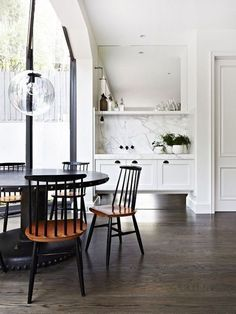 Simple dining space with black table and chairs