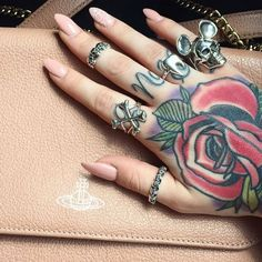 R o s e  The gorgeous hands of @charliebabz wearing Crossbones & Tooth ring. Shop here  http://ift.tt/2oonkJ8 #bloodymarymetal #TeamBMM