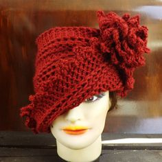 The Lauren hat is my signature one of a kind hat. It put my shop on the map. Machine wash warm. Air dry flat.  The lightweight Lauren crochet cloche hat with flower and matching leaf in autumn red has a zigzag asymmetrical brim that does not fall in your face. The left side sits under the crown while the right side flows above it. Change the look with one turn.  See other already made Lauren Crochet Cloche Hats with Flower in other colors - http://etsy.me/21X6JNI    MEASUREMENT...