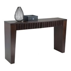This narrow two drawer console has an exotic and contemporary look. It is made of solid wood and veneer and is finished in a medium espresso brown stain.