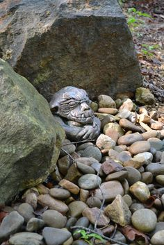Love this gargoyle settled amongst a pile of stones at Wamboldtopia in Asheville, NC