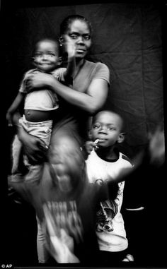 Haitian Marie Mirlande Caceus poses for a portrait with her sons, Miguel and Lilliam, and a family friend. Caceus, left homeless by Hurricane Matthew, migrated to Brazil and then the U.S. Mexico border. She and her husband have decided not to cross into the U.S. for fear of being deported back to Haiti. Caceus, whose main language is Creole, is slowly learning Spanish, adding amigo, hola, arroz, pollo y pantelon to her vocabulary