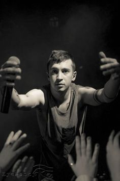 """Tyler Joseph :) He kind of looks like he's beckoning you to him, saying, """"Everything's going to be all right. People here understand, I've got you.""""<<<I WOULD GO TO HIM IN A HEARTBEAT"""