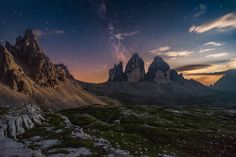 Dolomites moonset - Italian Dolomites at the Tre cime di Lavaredo. Moonset and milky way, the Dolomites comprises a mountain range in the northern Italian Alps.