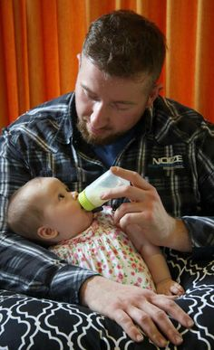 Boppy Pillow keeps baby and daddy relaxed during feeding time.