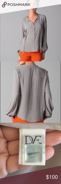DVF Whitney Blouse in Gray. NWOT! Never worn Billowy sleeves are an innately romantic feature of this Diane von Furstenberg top. Wear it buttoned up and tied for a poised and polished feel, or leave it loose and open for subtle sensuality. Round self-tie neckline; button front. Long, blouson bishop sleeves; elasticized cuffs. Relaxed silhouette. Viscose/rayon; dry clean. Imported. Diane von Furstenberg Tops Blouses