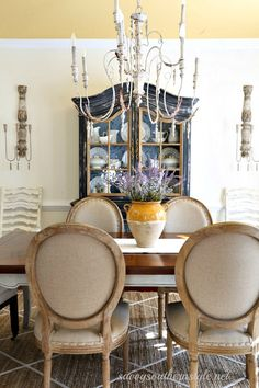 Savvy Southern Style: Herringbone, Tufts, and Tacks. French country style dining room, china cabinet, upholstered chairs.