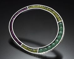 stiff outer form, strung interior, colors....Susan Kinzig bracelet, sterling and semiprecious stones