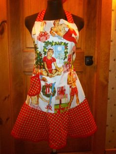 Naughty or Nice! I think Naughty! This is such a fun, festive apron, you will want to entertain and stay in the kitchen just to wear this Alexander Henry pin up holiday print of these muscle men bearing gifts🎄🎅. This is a great gift for any hostess giving a holiday party, bride-to-be, girlfriend, or partner.  It is 100% cotton, and is one size fits most. It is on a marshmallow colored background, with reds and greens. The ruffle, pocket and trim are red with lime green polka dots. Machine…
