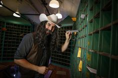 Buffalo Bill sorts mail in the mail car at the Cody Park Railroad Museum