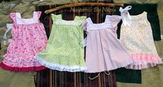 Sundresses, from left to right:  Pink, Apple green, Pale Purple, Reversible.