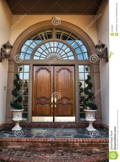 Photo about Two wooden front double doors entrance - 4722906