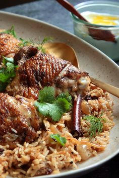 "NYT Cooking: A stunningly fragrant one-pot meal, this chicken and rice dish came to The Times from Yotam Ottolenghi and Sami Tamimi's smash hit ""Jerusalem: A Cookbook."" Spiced with cinnamon, cardamom and whole cloves, its aromatic earthiness is balanced by plenty of herbs — dill, parsley and cilantro — for freshness and tang. And caramelized onions and dried barberries (or currants) contri..."