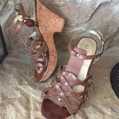 Guess brand cork wedges Worn a few times but great condition. Cork wedges with brown upper and gold rivets. Guess Shoes