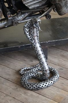Amazing hand built snake. That's all washers and sheet metal.. incredible