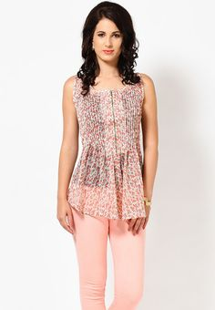 Beige coloured, printed top for women by People. This waist-length, sleeveless top is made of poly georgette and has a round neck. This top features pintucks.