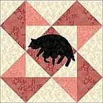 Mill Wheel quilt block with appliqued kitty