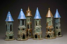 Fantasy Castles, made of clay. Wheel thrown and altered.  Each castle can hold a tea light, or simply enjoyed