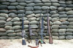 "Displayed weapons, from left to right, M16, M3 ""grease gun"", M1911, M16 with mounted M203 grenade launcher, M14."