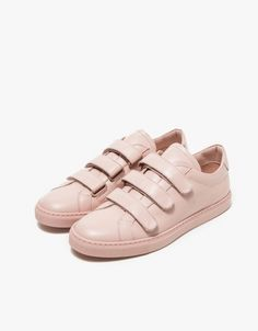 From Common Projects, a classic leather low top sneaker in Blush. Features a round toe, an allover Italian leather body, leather straps with velcro closure, leather lining, padded ankle, gold heat pressed serial number detail on heel and rubber sole. •
