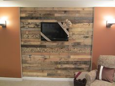 pallet wall hide all tv cords and shelves behind it could put cable and dvd box on shelves and make cut out for the front