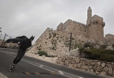 Rollerblading Batman passes the Tower of David in the 3rd annual marathon in Jerusalem.